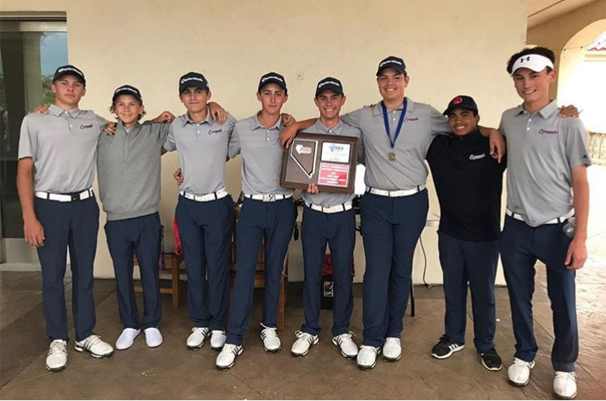 Finishing first, the men's golf team poses for a photo following their victory. Photo courtesy of Coach Sawaia