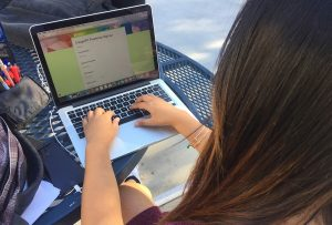 A student completes the CougarFIT sign up form online. Photo by Lexi Lane