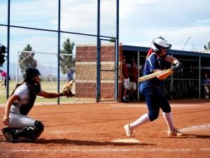#13, Katie Dawson, senior, hits a double sending in two runners to bring the Cougars up 13-0.  (Photo by Jolie Ross)