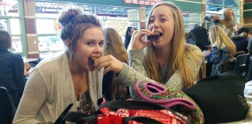 Digging into the their treat, sophomores Bonnie Stewart and Taylor Roylance share the Oreo cookie dough brownies during lunch. Photo by Saveria Farino