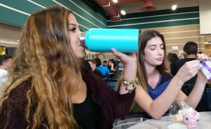 During lunch, Cambree Kalana, 11, enjoys a cold, refreshing sip of water from her Hydro Flask. Photo by Saveria Farino