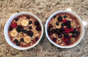 Mouthwatering açaí puree, decorated with fruit and granola, makes for a great healthy snack. Photo by Rosa Cesareo