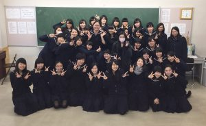 A class photo is taken at Hokusei Gakuen Girls' Junior and Senior High School with Sae Adachi, 11, and her homeroom classmates. Adachi is the tall girl with the glasses seen grinning in the middle. Photo courtesy of Sae Adachi