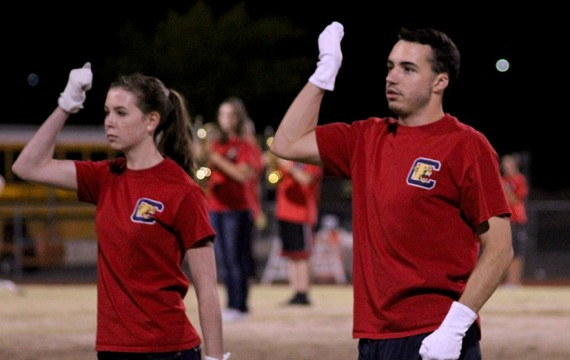 Senior drum majors, Sara Petty and Ryan Everson, lead the marching band during a home game. (Photo by Hailey Hoffman)
