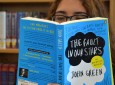 A student indulges in The Fault In Our Stars in the library.  (Photo by Leilah Lockett)