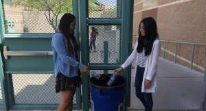 Caption for photo: Freshmen Vanessa Vidas and Alessandra Baldono recycle their water bottles during lunch.