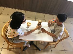 Enjoying their crepes at Crepe Shack & Waffles, Janelle Rafanan, 11, and Corey Masicampo, 10, play a game of Jenga while on a date.