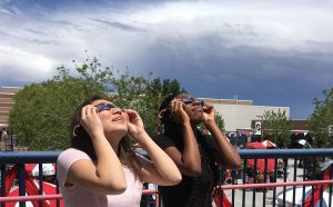 Wearing special glasses, Lisa Blair, 12, and Alexis Washington, 11, view the partial solar eclipse during their AP Environmental Science class.