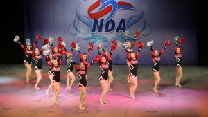 Striking a pose, the Cougarettes end their Pom routine, which earned eighth in the nation. Photo Courtesy of Sara Advent