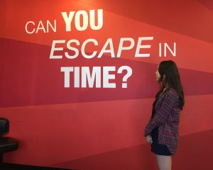 "Pondering the question, Sara Seibel, 11, prepares to enter ""The Atelophobia"" escape room at Countdown Escape Games. Photo by Bekah Denny"