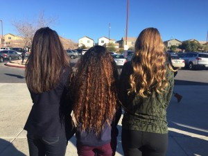 All showing off their unique hairstyles, Katelyn Virgen, Kaylee Heiny, and Olivia Yamamoto, freshmen, embrace their different locks and personalities. Photo by Saveria Farino