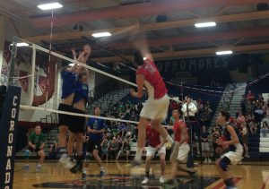 In senior night action, Ryan Garlic smashes the ball on Green Valley for an easy kill. Photo by Joshua Christensen.