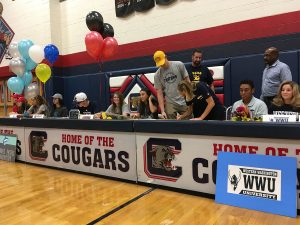 While athletes await their turns to sign contracts for their college teams on Monday, Nov. 14, Kennedy Koehler, 12, commits to UCSD. Photo by Saveria Farino