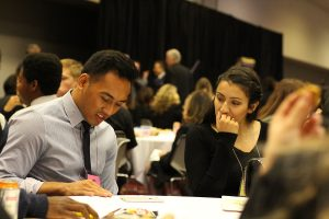 Taking a break for lunch, seniors Justin Balanga and Nina Machin continue to discuss their topics at the Sun Youth Forum. Photo by Taylor Dickerson