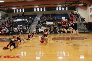 Dominating the audience's attention, the Cougarettes performed their pom routine, taking home first place. Photo by Karen Pegueros