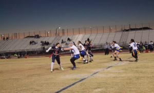 On her way to help her team, Caitlin Shannon, 10, maneuvers around oncoming Sierra Vista players. Photo by Sage Tippie
